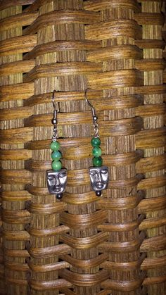 Faceless - Green - The profit from the sale of these earrings helps to rescue a victim of human trafficking AND money is contributed to eradicate poverty!