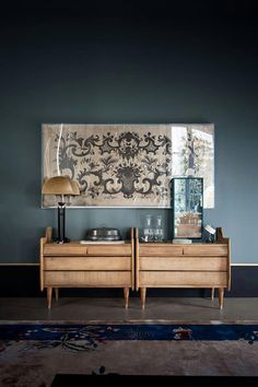 Dusty blue / cornflower walls - Vintage chinese deco rug - Oak (?) nightstands / side tables - Framed textile - Dark moody