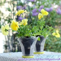 Old glass shades from light fixture as pots for plants.  Painted jar lids for saucers!  Clever!