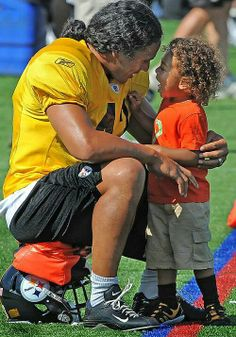 Troy and his son so sweet. Such a good Steeler Daddy! That's a future Steeler right there!