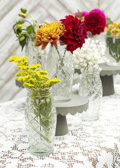 Our clear glass antique heirloom vase inspires vintage design with its embossed glass look and scalloped edge.