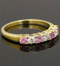 18Carat Yellow Gold Pink Sapphire 0.40ct & Diamond 0.30ct Eternity Ring (Size P)  https://www.jollysjewellers.com/product/18carat-yellow-gold-pink-sapphire-0-40ct-diamond-0-30ct-eternity-ring-size-p/