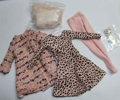 """Nice """"Cozy Coat & Dressy Dress"""" outfit originally worn by a 16"""" Wilde Imagination Lizette doll. Includes a pink and brown long-sleeved dress beneath a pink multi boucle coat with sequins, pink tights, gloves, and a fuzzy faux fur scarf in soft pink."""