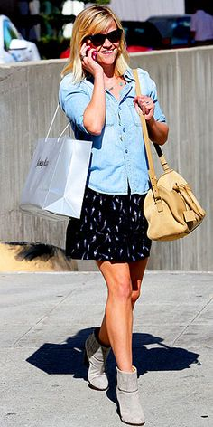 Love Her Outfit! | REESE WITHERSPOON | The entire style team has been wearing chambray shirts with skinny jeans every single Friday since October, so we're grateful to Reese for showing us how to take our denim button-downs into spring: untucked with a printed skirt (hers is Rebecca Taylor) and neutral booties (any will do if you don't have the budget for her Rag & Bone pair).