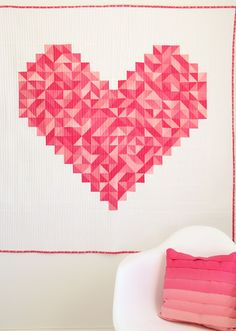 """i heart you"", 57 x 57"" or 108 x 108"", design by Vanessa Christenson.  A pink ombre fabric, designed by Vanessa for Moda, is used to provide the shading."