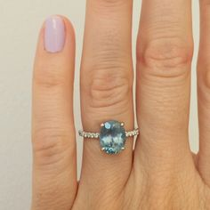 Custom solitaire with 3 caret blue Malawi sapphire set in platinum with white diamond micro pave.