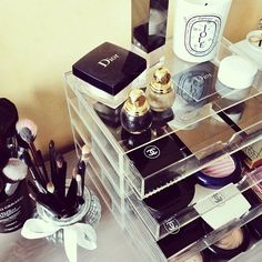 Does have to be Dior and Chanel...just love the pretty display/organization.