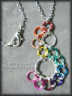 "Rainbow Silver Stepping Stone Chain Mail Pendant and Necklace - JEWELRY AND TRINKETS - The flowing ""Stepping Stone"" pattern chain mail pendant in silver and rainbow colored rings hangs from a sterling silver small link necklace Jump Ring Jewelry, Wire Jewelry, Jewelry Crafts, Beaded Jewelry, Silver Jewelry, Jewelry Necklaces, Handmade Jewelry, Jewlery, Chainmaille"