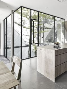 Neutral colours, simple lines and plenty of glass make this minimalist design a modern style.
