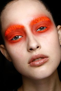 Orange high fashion make up backstage
