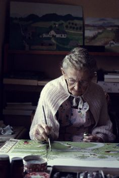 One hundred-year-old artist Grandma Moses (1860-1961) painting at her farm in 1960.