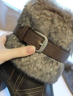 Dress up old boots with a fur collar and buckle.