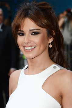 Cheryl Cole: Long, wispy bangs look amazing on thick hair types, and a high, voluminous ponytail draws attention to the cheekbones for a slimming effect.