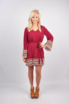 Get ready to dance the night away in our Solid Dress with Bell Sleeve! This dress has a bell sleeve, and printed detail throughout. With a tie around the waist, and a peek-a-boo back, all eyes will be on you in this flirty and fun dress! Get this dress online at www.VirgoBoutique.com!