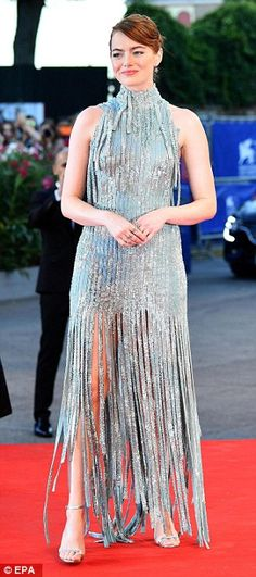 Emma Stone slips into negligee-inspired mini as she catches water taxi