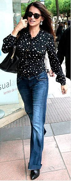 Who made Penelope Cruz's black long sleeve top and black leather handbag that she wore in Madrid?