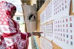 A woman looks at the list of candidates outside a polling station in Stone Town, Zanzibar. (Daniel Hayduk/AFP via Getty Images)