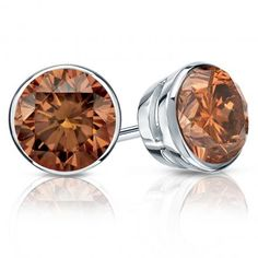 Add a pop of color and vibrant twist to your pair of stud earings, with our fancy brown diamonds.