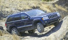 JEEP: A Brief History <> Jeep Grand Cherokee: 2005–2010 <> The Grand Cherokee was redesigned for 2005 with a focus on combining power and luxury with a quieter, more refined ride by adding a new short/long-arm front suspension. Three engines were offered, including a 330-horsepower 5.7-liter HEMI and the available full-time Quadra-Drive II 4×4 system featured front and rear limited slip differentials and a center differential lock. © FCA US LLC