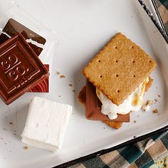 Deep-Fried S'mores | We're breaking the rules by deep frying marshmallows for a perfect 4th of July treat! | #Recipes | SouthernLiving.com