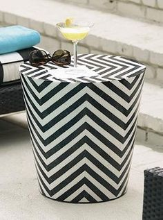 With contemporary chevron patterns, the handmade Cadize Stool utilizes black-and-white fossilized stones to create a sleek decorating accent.