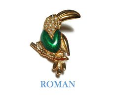 "Use code SOCIAL15 for 15% off all purchases over $15, plus FREE shipping on most jewelry! Roman signed Toucan brooch, green enamel pin, pave rhinestone, green eye, figural bird on branch, gold tone.   Measuring 2"" (5.1 cm) X 1 "" (2.5 cm) it is in very good vinta... #etsygifts #vintage #vjse2 #jewelry #gift ➡️ http://jto.li/t2rxJ"