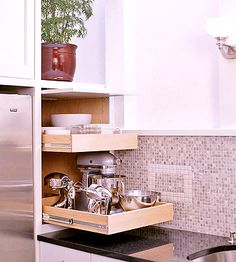 Appliance Garage: Pull It - Pullout drawers inside this appliance garage offer multiple storage levels. This versatile system houses a variety of appliance sizes, making it an organized system that includes all odd-shaped items.
