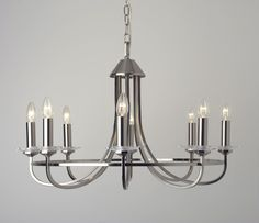 A larger scale light fitting and a lovely centrepiece for any classic contemporary or traditional interior. The crystal sconces add a touch of glamour to the understated elegance of the Carosello. If you prefer not to see the bulb pop on a clip shade. http://www.styleandlight.com/carosello-8-light-satin-nickel-chandelier