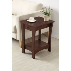 Complete the look of your living decor with this gorgeous work of art. This end table features reliable single drawer on metal glides, with an underneath open shelf, all coated in warm vintage finish, along with its effortless lateral curves.