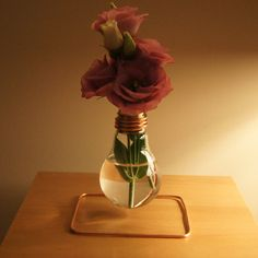 Bulb Vase. Once It was the 40 watt bulb but when it came into my hands, bulb has evolved into stylish and original vase.