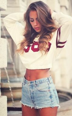 Stylish mini white blouse with denim jeans shorts and necklace