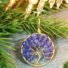With its unique blue-violet color, Tanzanite is a striking gemstone. Found only one place in the entire world! Handmade, 14k gf yellow gold tree of life pendant by PhoenixFire Designs will be sure to light up her holiday season! Ready to ship. 💜