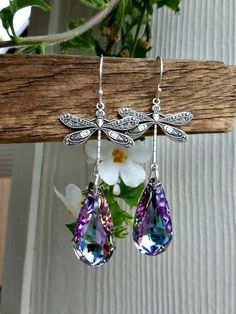 Earrings are delicately hanging from silver dragonfly charms, thin and Lightweight and super blingy! The crystals are made from Swarovski Crystal Passions 22 mm faceted teardrop pendant. These crystals have so much sparkle! This is with Sterling Silver ea How To Make Earrings, Beaded Earrings, Earrings Handmade, Handmade Jewelry, Earrings Uk, Swarovski Jewelry, Crystal Jewelry, Swarovski Crystals, Silver Jewelry
