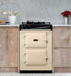Aga. If you would love an Aga but only have a small kitchen, there is finally a solution! The Aga City 60 is the same size as a standard over but does the same things that a conventional Aga does, but on a smaller scale. www.agaliving.com