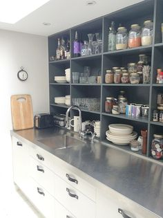 Mad about the house kitchen. Love the worksurface and shelving. Slightly concerned about having to dust tho!