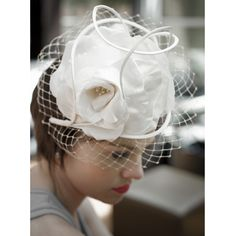 Large off white hand sculptured satin rose with satin roulette and veiling.