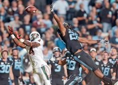 Miami's Phillip Dorsett (4) reaches for a pass as North Carolina's Dominique Green (26) defends. The pass was complete. (Gerry Broome/AP)