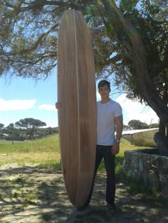"""Dean Strumpman with the 9'.6"""" longboard he built on a www.burnettwoodsurfboards.co.za course. Wooden Surfboard, Surfboards, Dean, Building, Pictures, Photos, Buildings, Skateboards, Construction"""