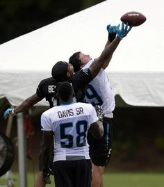 Carolina Panthers' Kelvin Benjamin (13), Luke Kuechly (59) vie for a pass as Thomas Davis, Sr (58) looks on during a break at Carolina Panthers Training Camp at Wofford College in Spartanburg, SC on Sunday, August 9, 2015.