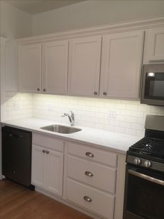 White Cabinets And Subway Tile, Corian Raincloud, Slate Appliances