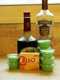 Shamrock Shake Pudding Shots In a large bowl, whisk together one packet of vanilla pudding, cup vanilla vodka and cup creme de menthe. When this is mixed well, fold in one container of cool whip. Spoon into clear plastic pudding shot cups and a Party Drinks, Cocktail Drinks, Fun Drinks, Yummy Drinks, Alcoholic Drinks, Mixed Drinks, Yummy Shots, Shots Drinks, Disney Cocktails