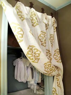 Allow linen closets to breathe-outside door with hooks holding closet curtain-one of my favorite looks