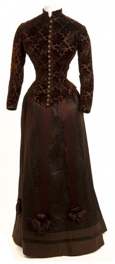 Two-piece brown dress is a silk satin skirt and silk velvet brocade bodice apparently at John Pillsbury gubernatorial inaugural ball. Circa 1880s.