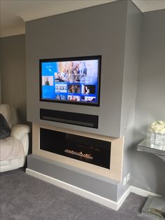 Television over Bio-ethanol fireplace. We built out a false chimney breast off a flat wall. Created recess for the television. Fireplace Tv Wall, Bioethanol Fireplace, Bedroom Fireplace, Tv In Bedroom, Living Room With Fireplace, Fireplace Design, Chimney Decor, False Wall, Front Rooms