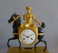 """Antique French Empire clock of """"La Laitiere"""" in patinated bronze and ormolu. -"""