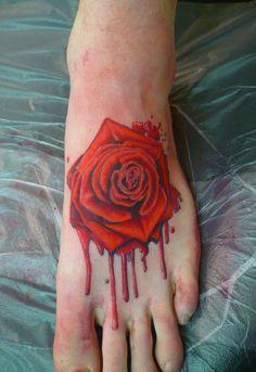 bleeding rose tattoo