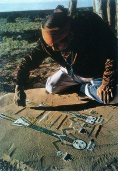 Upstate Arizona, a Navajo medicine man invokes water deities with a ceremonial sand painting.  National Geographic - August, 1980