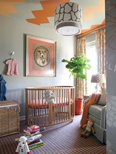 Not sure what I love most in this nursery...the houndstooth carpet, the ceiling treatment or the paintingof the pit bill over the crib.  Great mix of pattern...Love!