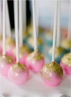 Cake Pops with edible fairy dust// only I'd do the cake pops in a stand with the fairy dust on top of the pop