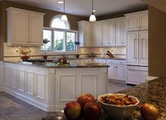 Browse through pictures of kitchens in our gallery of traditional off-white antique kitchen cabinets.